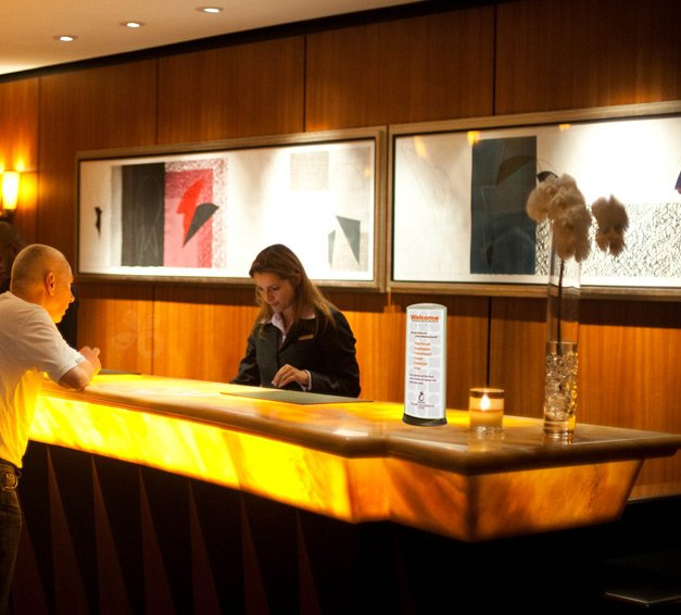 Podia tabletop display for Hotel signs